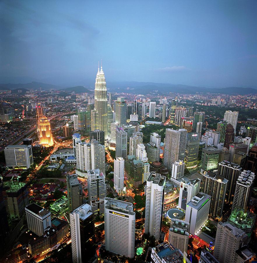 Malaysia, Kuala Lumpur Skyline At Dusk Photograph by Martin Puddy