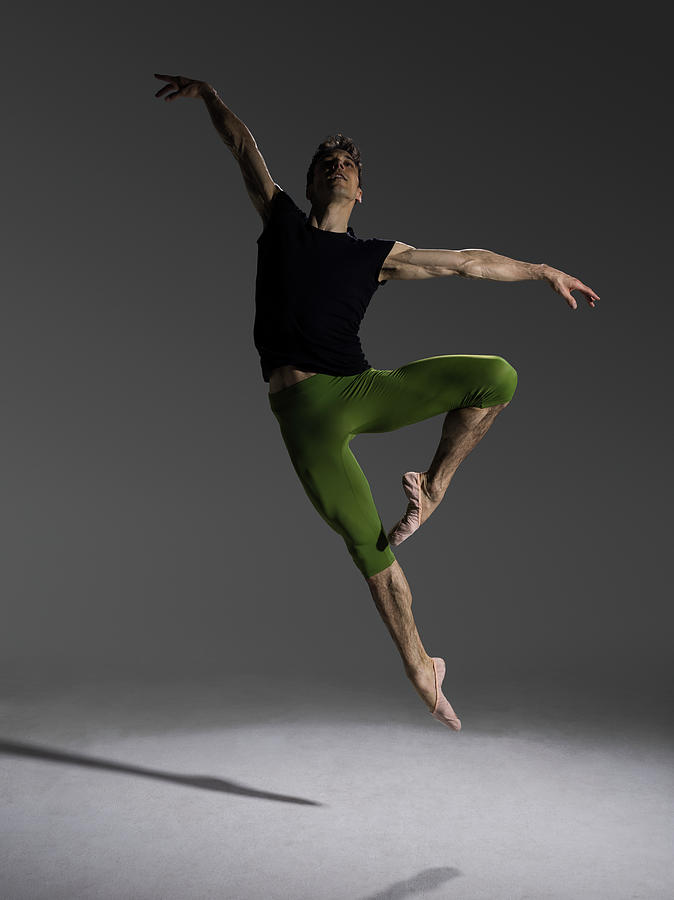 Male Ballet Dancer Jumping In Passé Photograph by Nisian Hughes