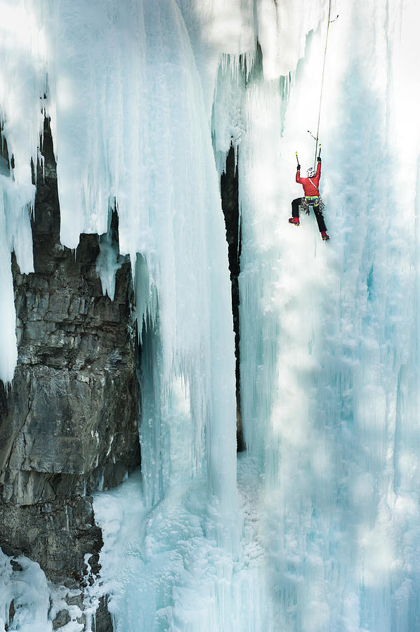 Male Ice Climber Scales Big Ice-covered Photograph by Kjell Linder