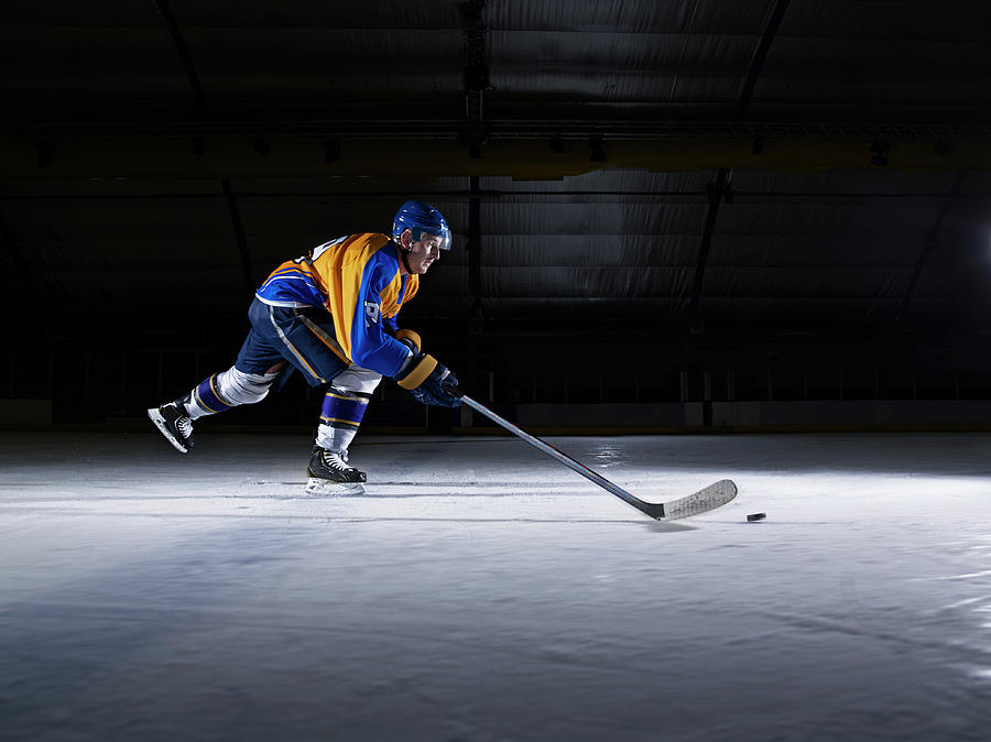 Male Ice Hockey Player Skating With Photograph by Mike Harrington