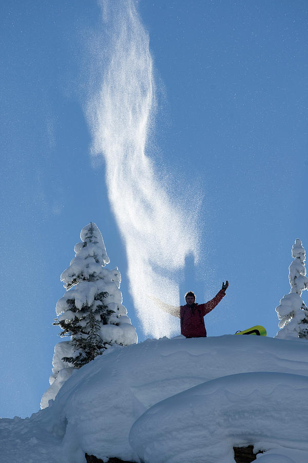 Back Light Photograph - Male Snowboarder Throwing Powder by Adam Clark