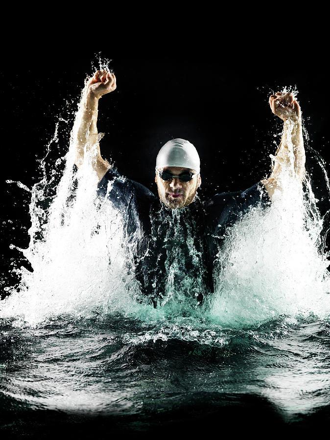 Male Swimmer In Spray Of Water Photograph by Henrik Sorensen