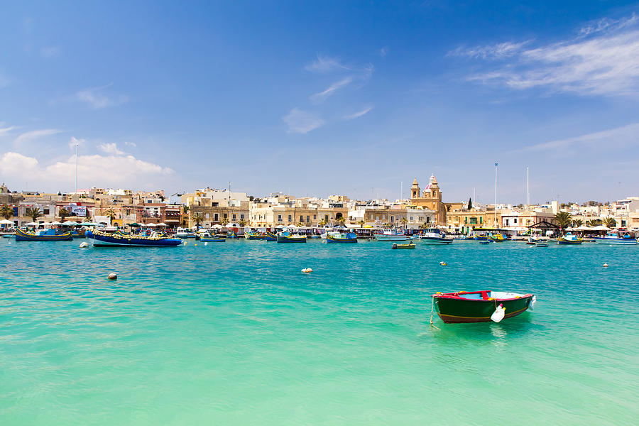 Malta, Marsaxlokk, View Of Fishing Village Photograph by Wahju_widjajanto