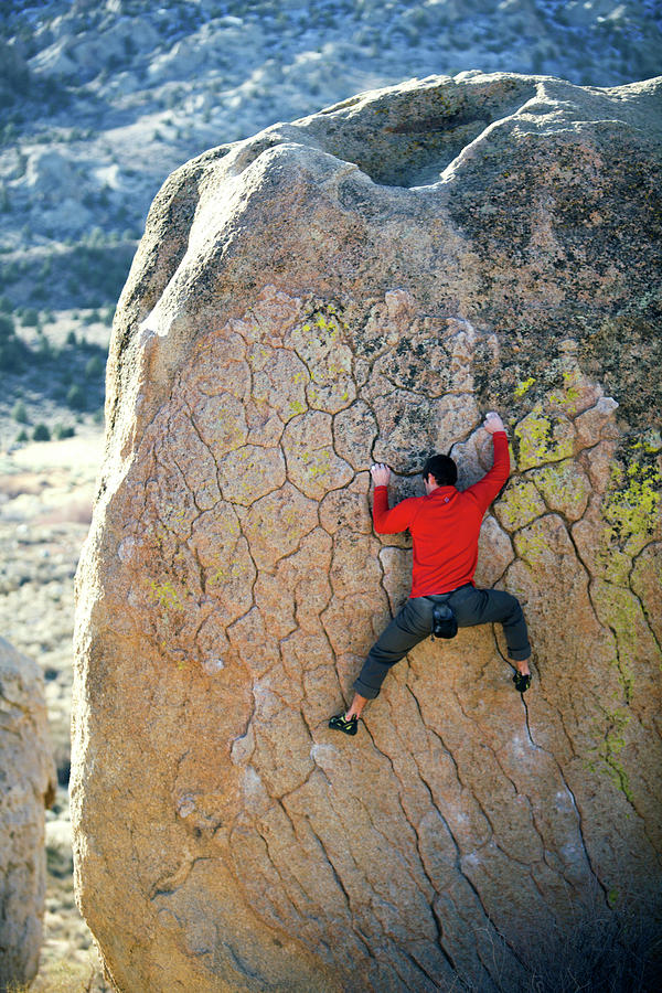 Action Photograph - Man Bouldering On An Overhang by Corey Rich