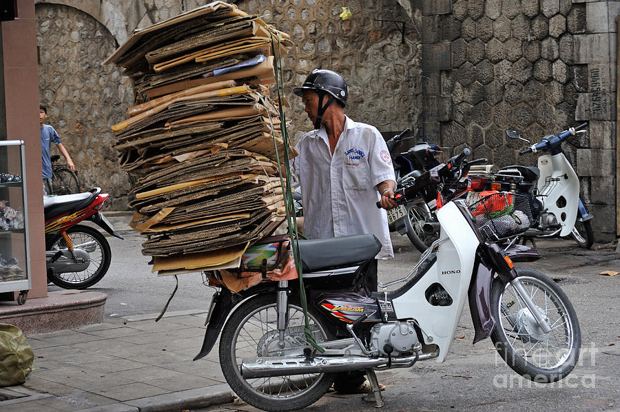 Man Photograph - Man Carrying Cardboard On The Back Of His Scooter by Sami Sarkis
