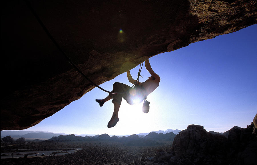 Action Photograph - Man Climbing On An Overhang In Joshua by Corey Rich