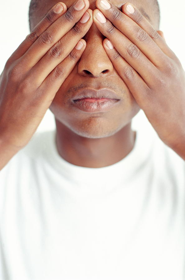 Man Covering Eyes With Hands Close Up By Antony Nagelmann
