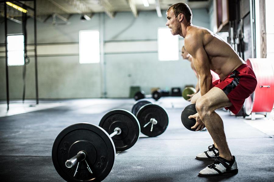 Man Doing Gym Medicine Ball Slams Photograph by Momo Productions