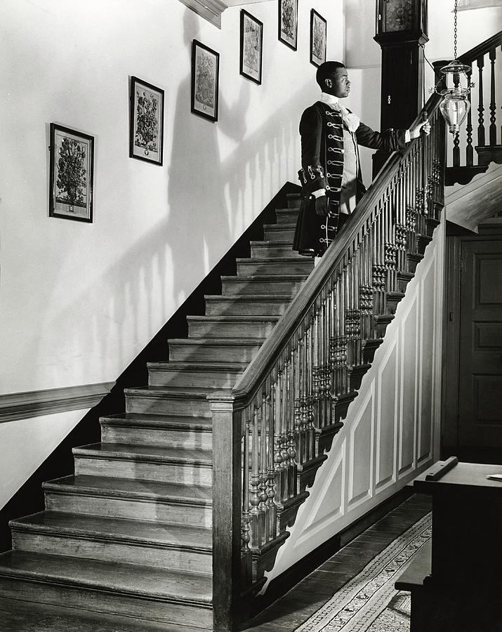 Man Dressed As Colonial Butler On The Stair Photograph by George Karger