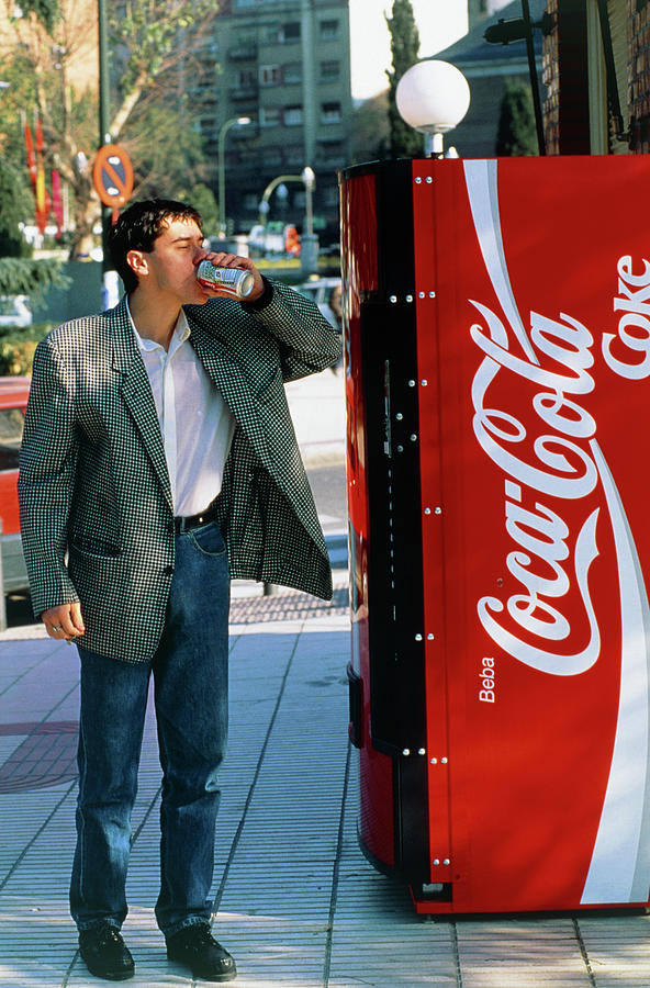 Drinking Photograph - Man Drinking A Can Of Coke by Marcelo Brodsky/science Photo Library