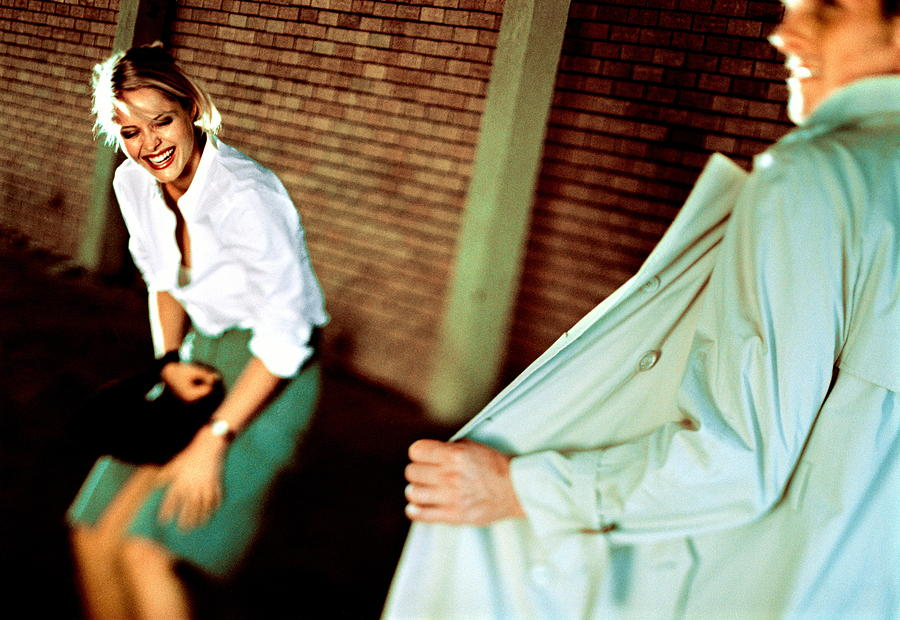 Man Exposing Himself In Front Of Woman, Woman In Fits Of Laughter Photograph by Laurence Monneret