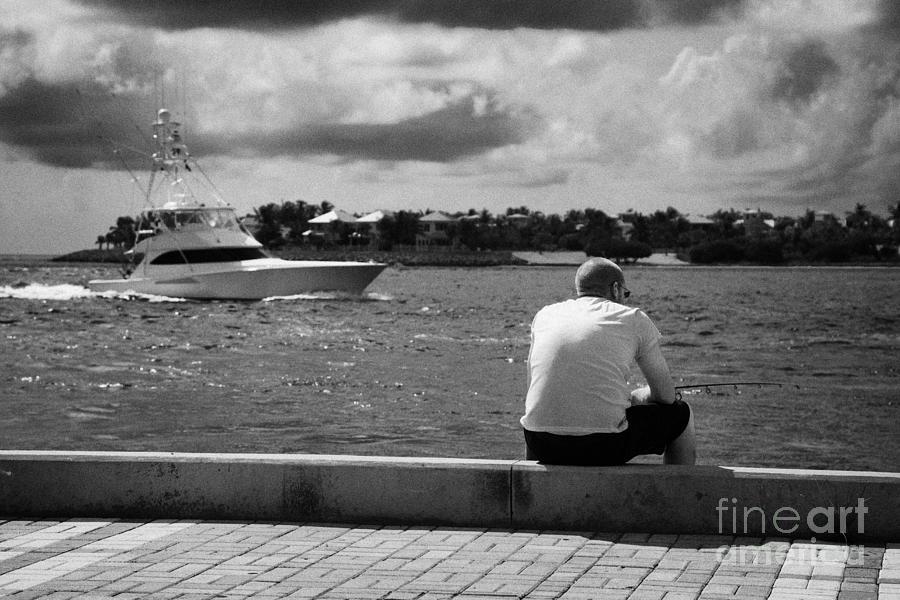 Man Photograph - Man Fishing On Mallory Square Seafront Key West Florida Usa by Joe Fox