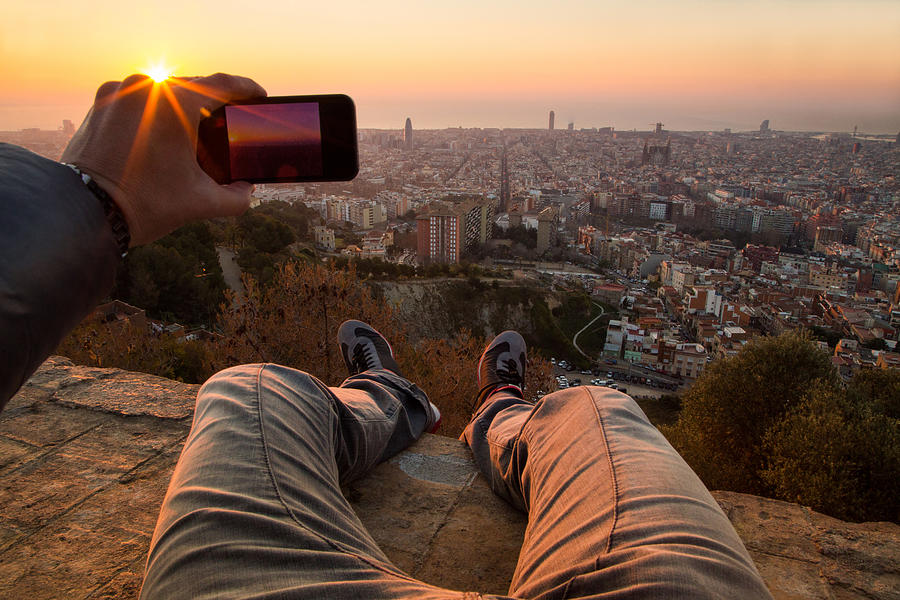 Man from pov taking pictures on Barcelona sunrise. Photograph by Artur Debat
