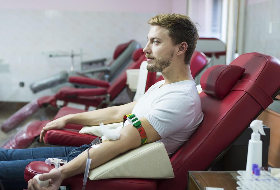 Man giving blood donation Photograph by Vesnaandjic