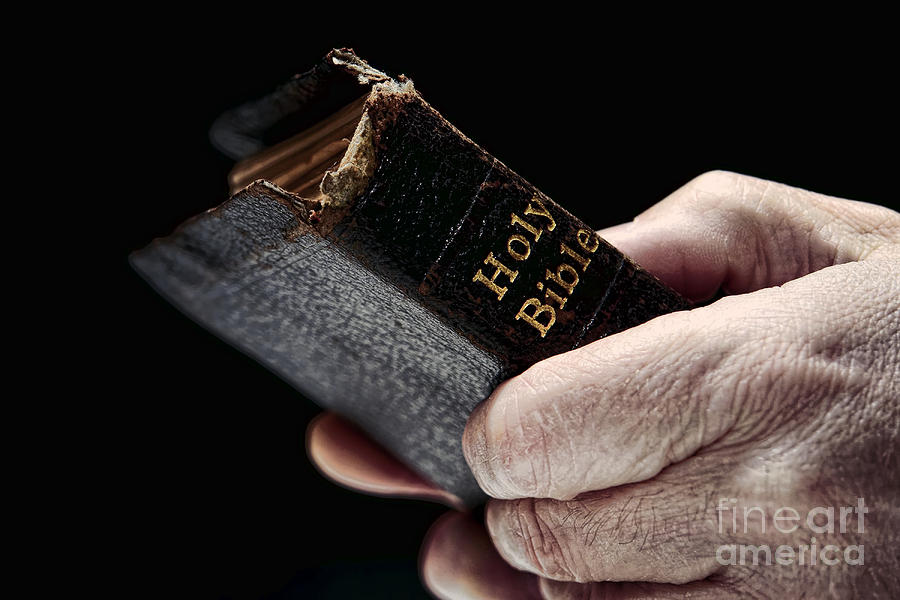 Man Photograph - Man Hands Holding Old Bible by Olivier Le Queinec