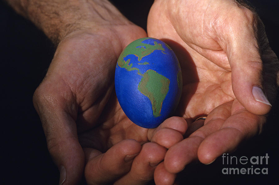 Carry Photograph - Man Holding Earth Egg by Jim Corwin