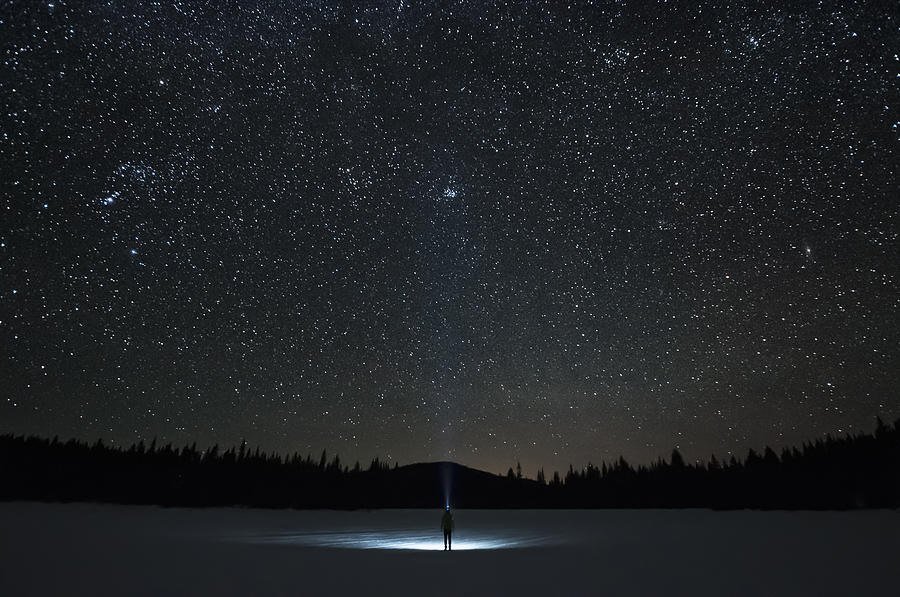 Man looking up at Pleiades star cluster and Orion constellation, Nickel Plate Lake, Penticton, British Columbia, Canada Photograph by Preserved Light Photography