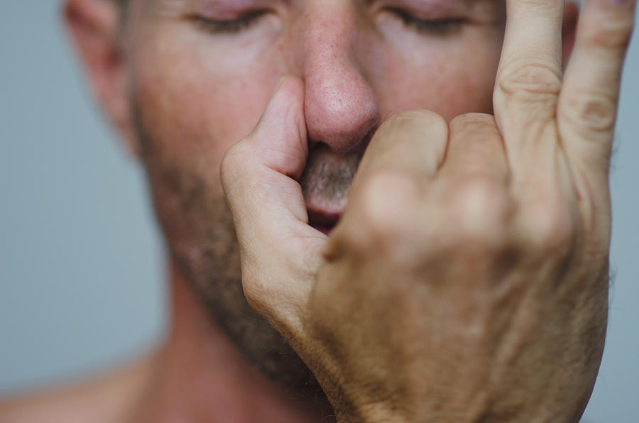 Man Performing Alternate Nostril Breathing Photograph by PeskyMonkey