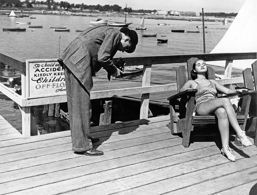 1937 Photograph - Man Photographs Sleeping Girl by Underwood Archives