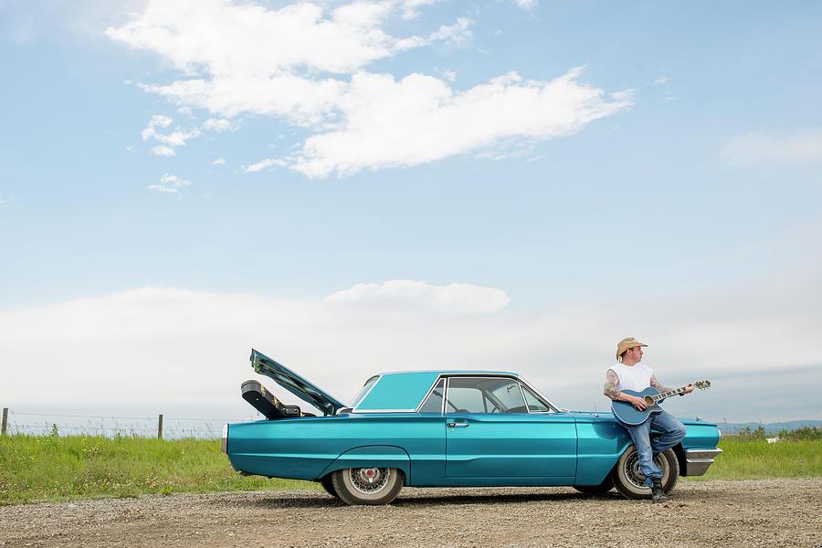 Man Rests Against Older Model Car Photograph by Ascent Xmedia