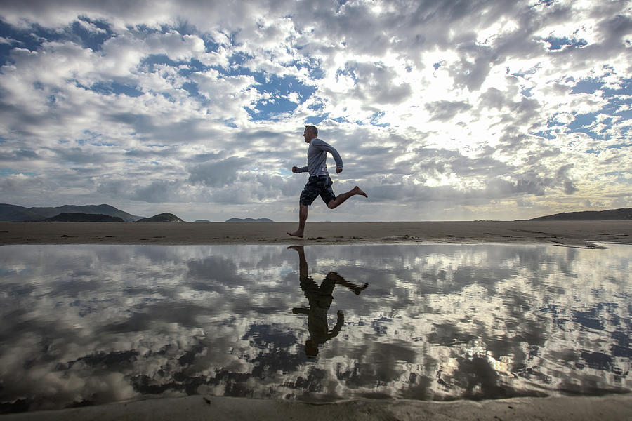 Man Running On Beach Photograph by Paul Mansfield Photography