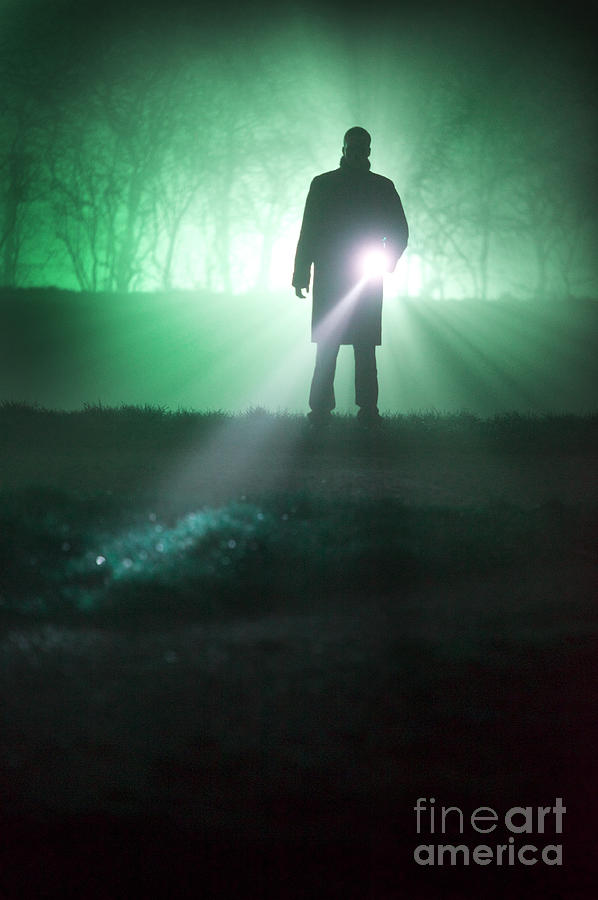 Man Searching With Torch Or Flashlight At Night Photograph