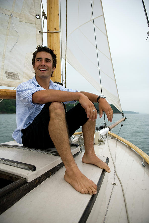 Bay Photograph - Man Smiling On Sailboat, Casco Bay by Peter Dennen
