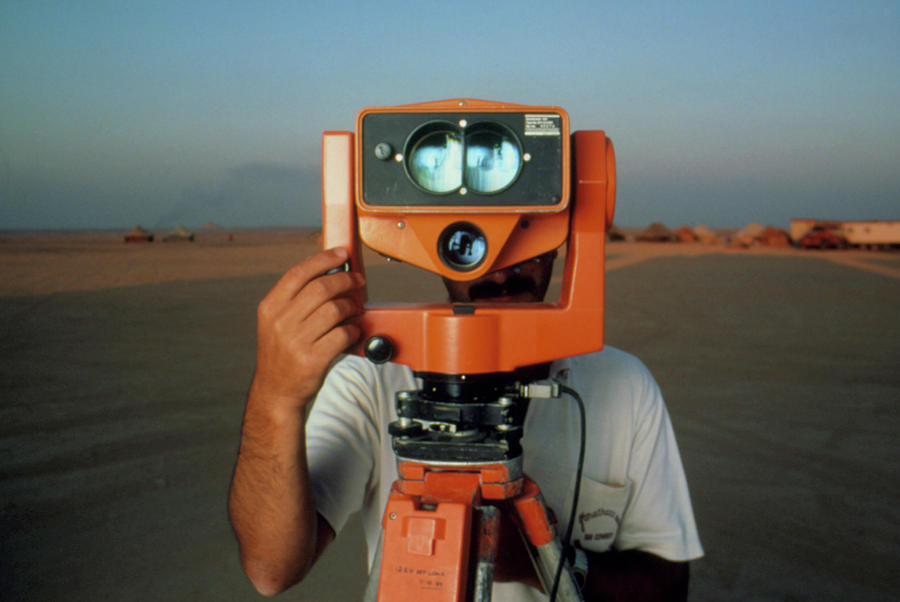 Telemetry Photograph - Man With A Survey Instrument In The Libyan Dessert by Joe Pasieka/science Photo Library