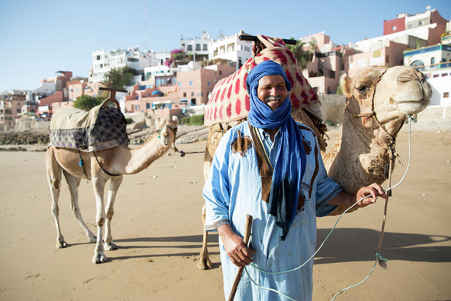 Man With Camel On Beach, Taghazout Photograph by Tim E White
