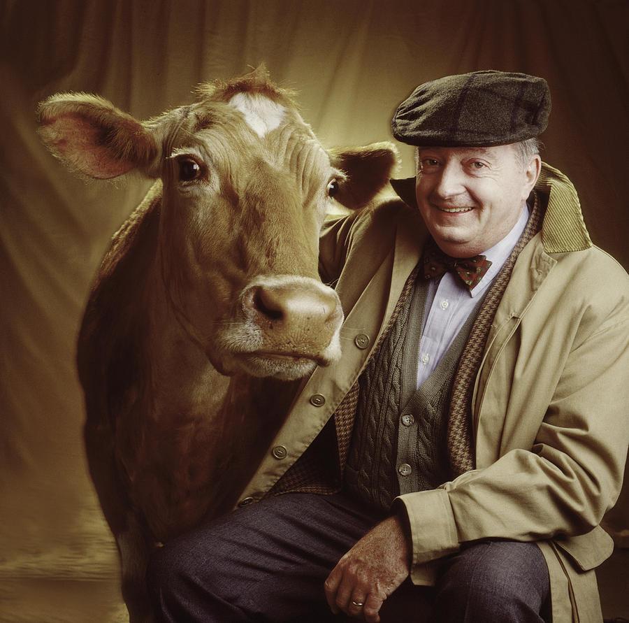 Man Photograph - Man With Cow by Ken Tannenbaum