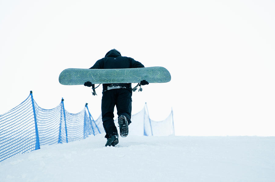 Man With Snowboard Moving Up Photograph by Helena Wahlman