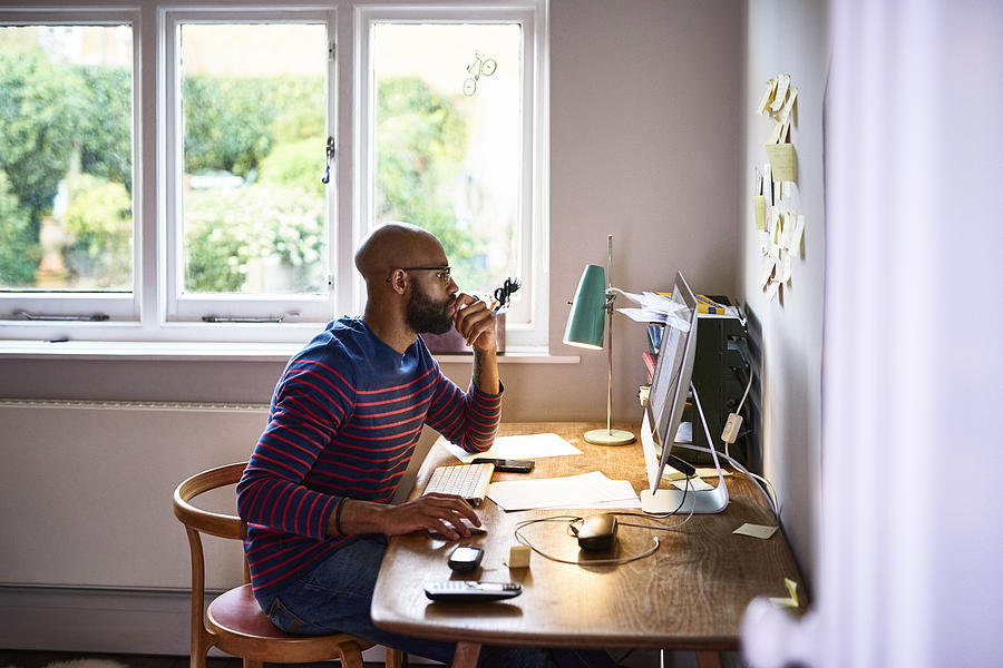 Man working at home Photograph by 10000 Hours