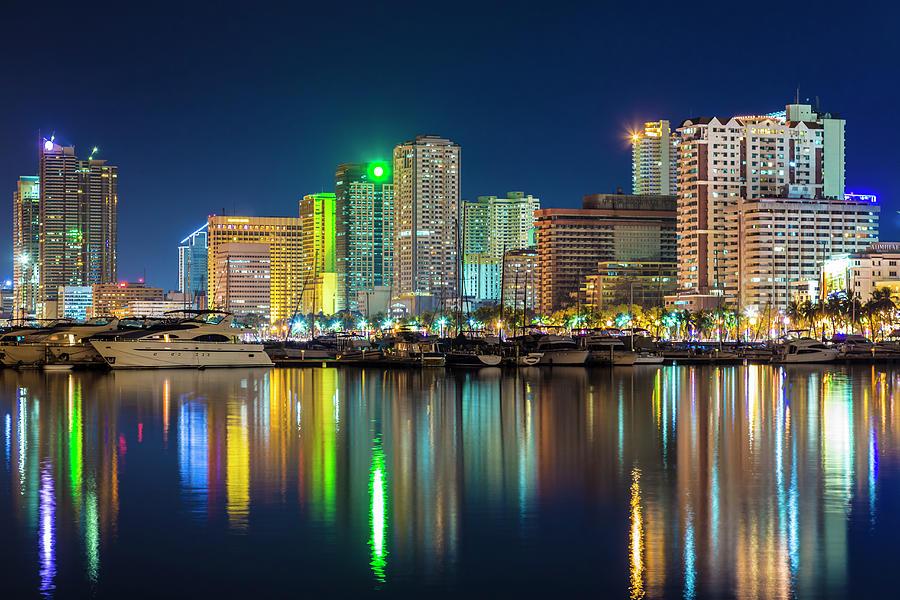 Manila City Skyline At Night Photograph by Stuart Dee