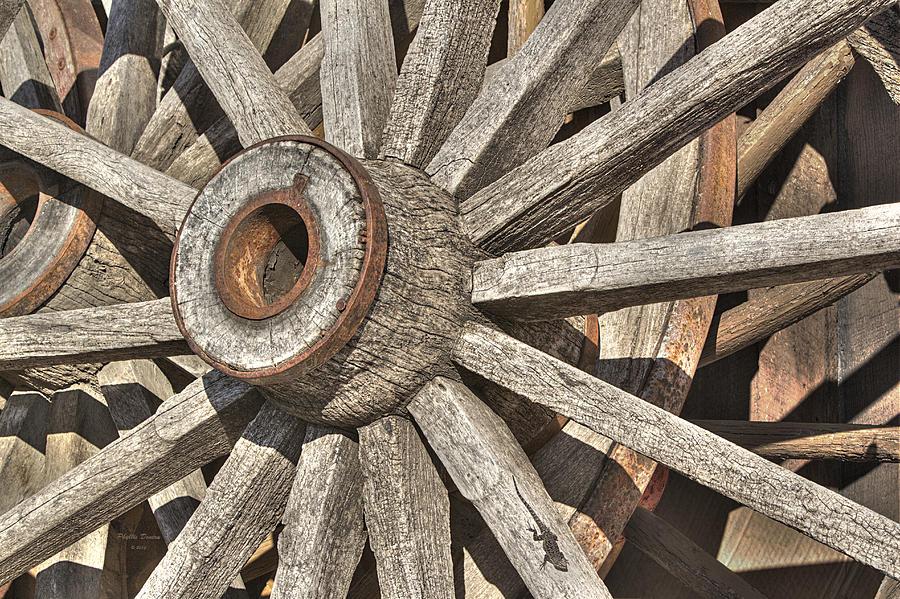 Wheels Photograph - Many Wooden Wheels by Phyllis Denton