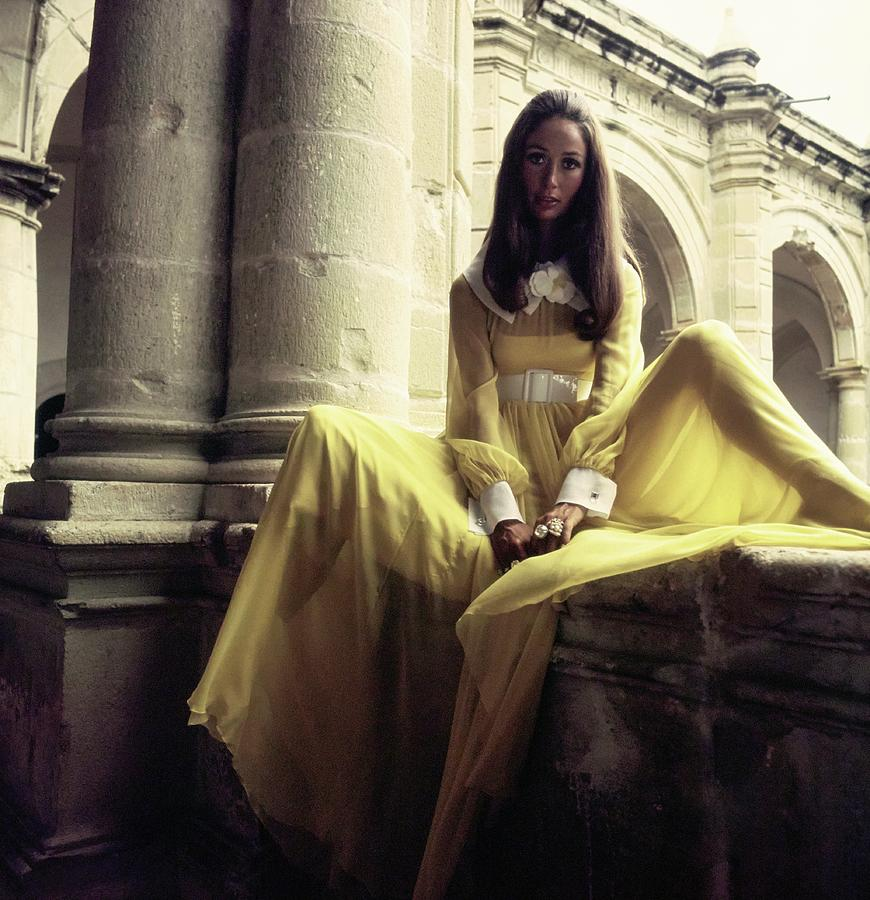 Marina Schiano Wearing A Yellow Dress Photograph by Henry Clarke