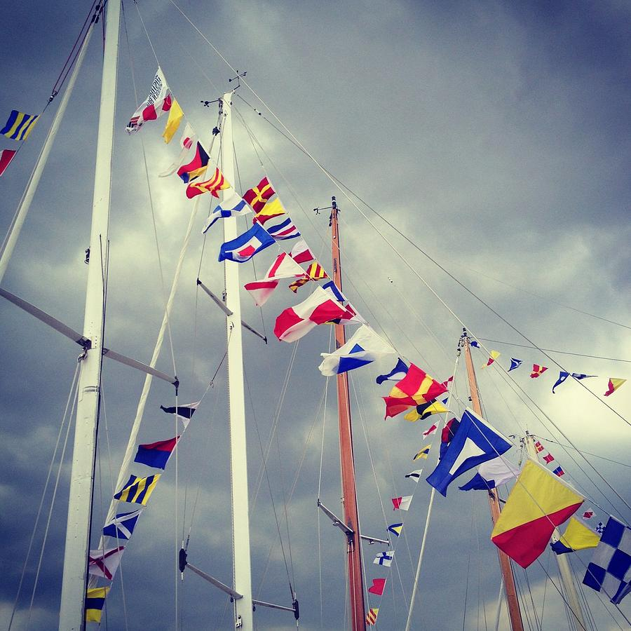 Marine Signal Flags On Mast Against A Photograph by Jodie Griggs
