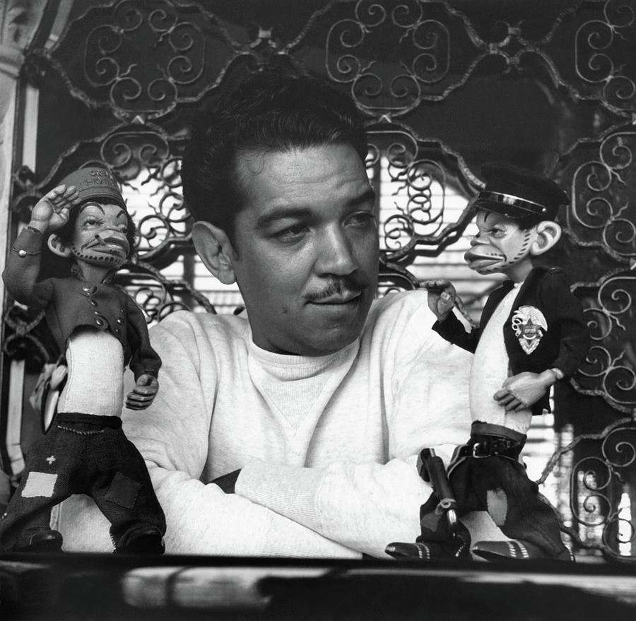 Mario Moreno With Two Dolls Photograph by Horst P. Horst