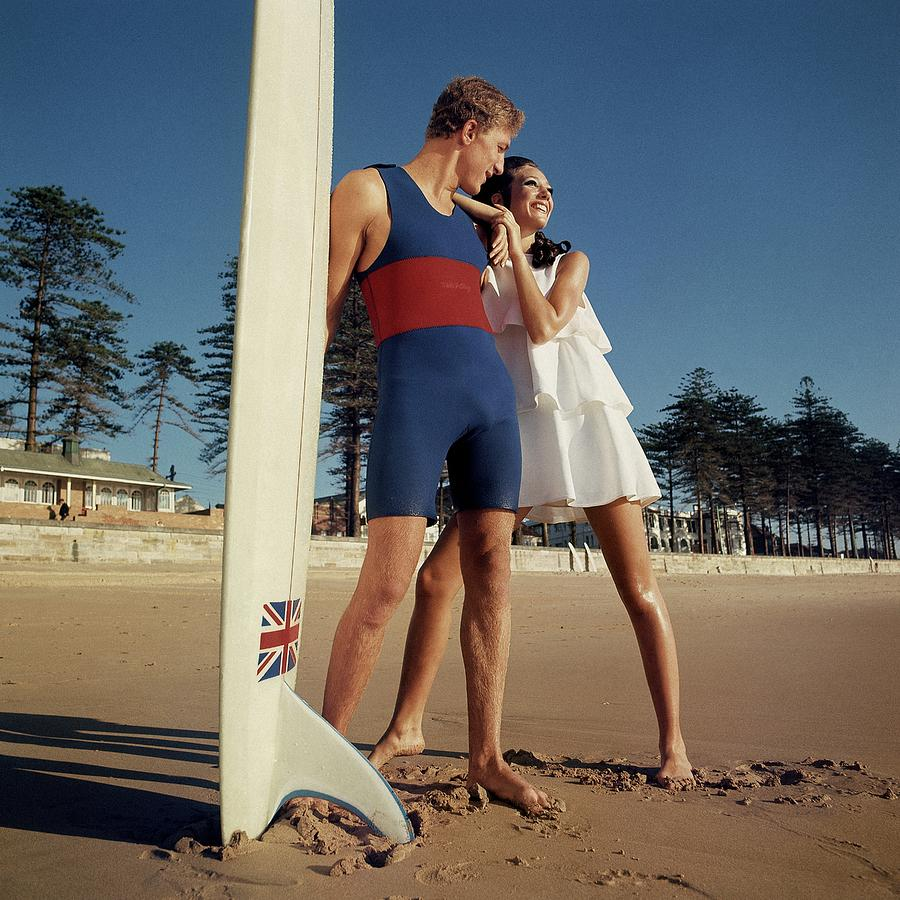 Marisa Berenson And Nat Young On A Beach Photograph by Arnaud de Rosnay