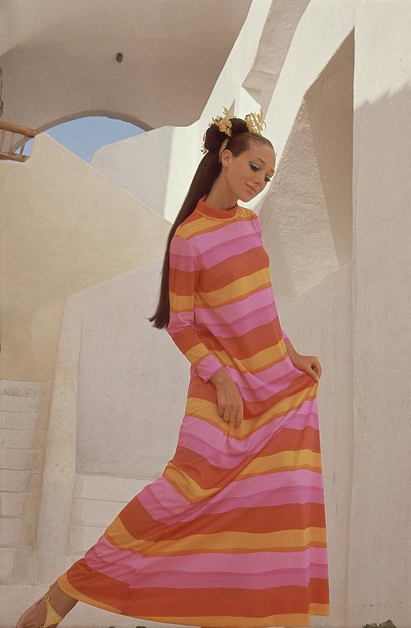 Marisa Berenson In A Bright Striped Dress Photograph by Henry Clarke