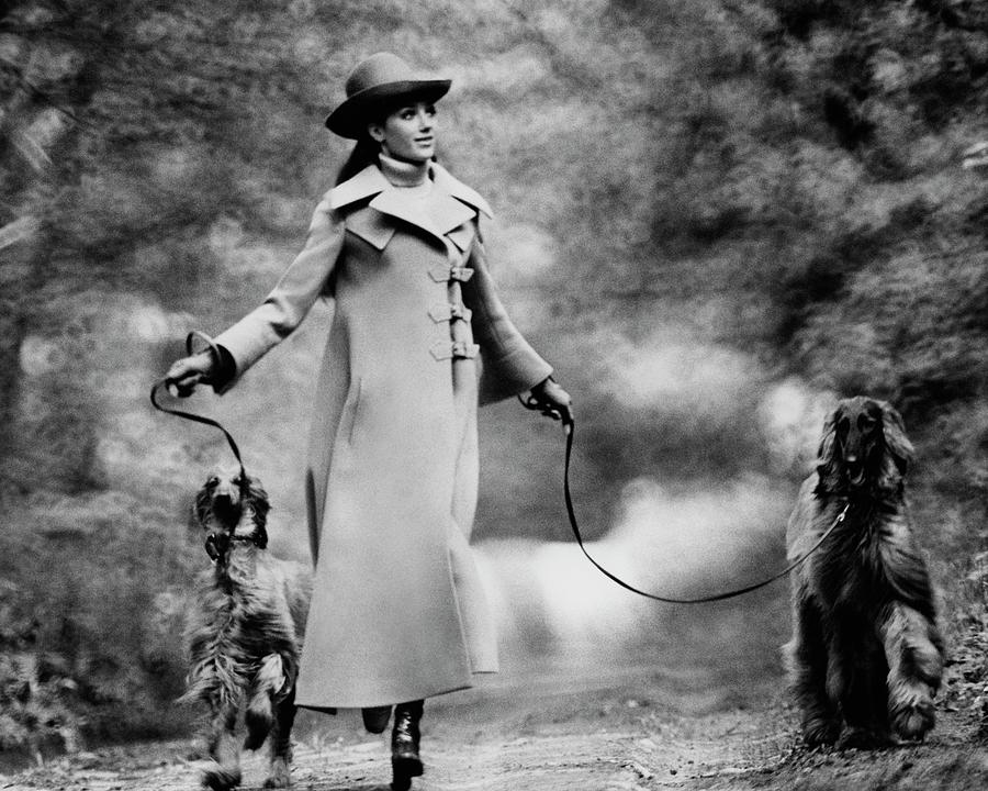 Marisa Berenson Walking Two Dogs Photograph by Arnaud de Rosnay