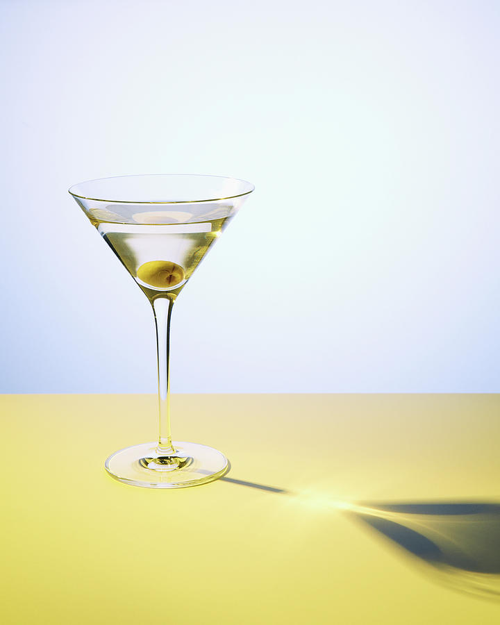 Martini In Martini Glass With Olive Photograph by Felicity Mccabe