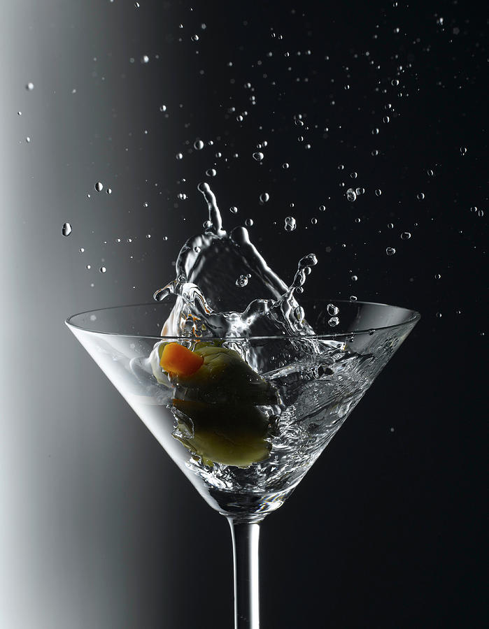Martini With An Olive Splash Photograph by Howard Bjornson