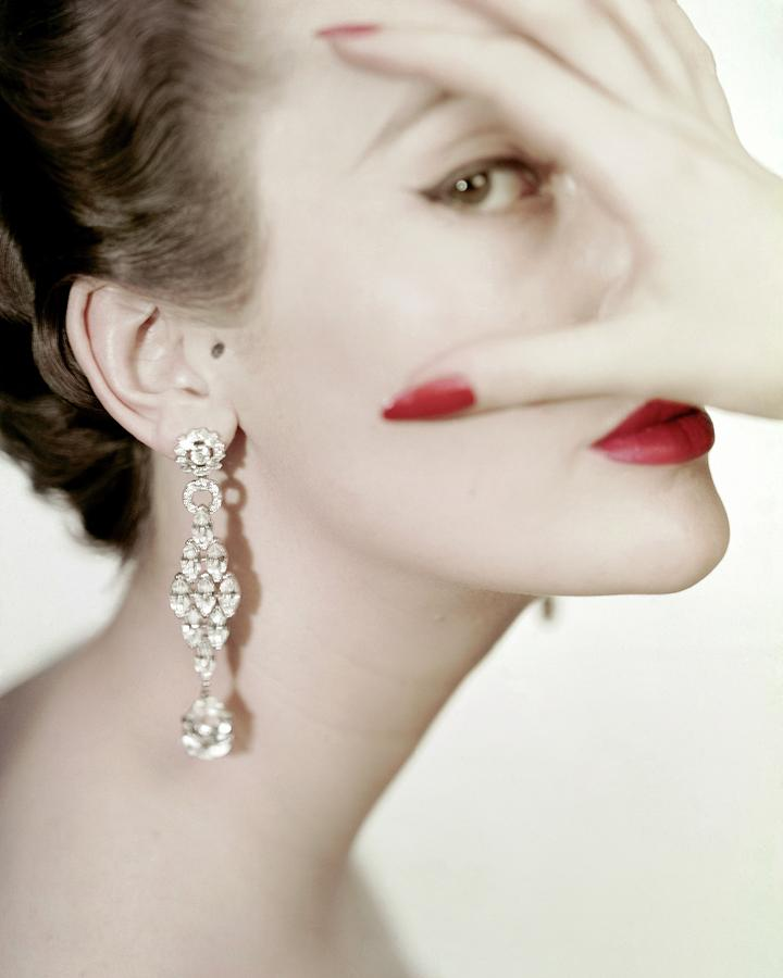 Mary Jane Russell Wearing Earrings Photograph by Clifford Coffin