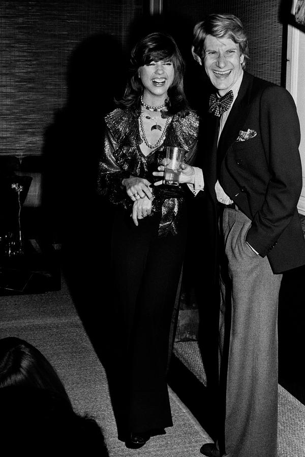 Mary Russell Laughing With Yves St. Laurent Photograph by Henry Clarke