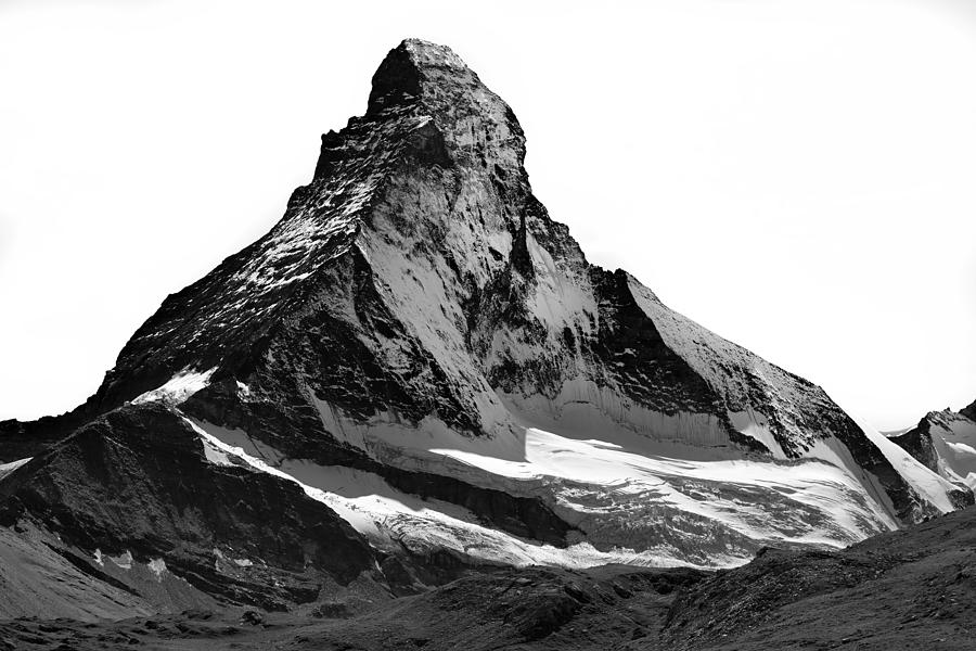 Matterhorn north face, snow capped, triangle shaped, high-contrast black and white. Photograph by Andrew Merry