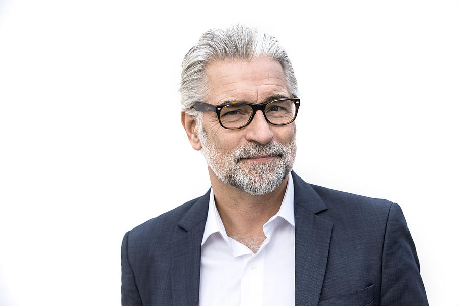 Mature Grey-haired Man In Suit Smiling Photograph by Robin Skjoldborg