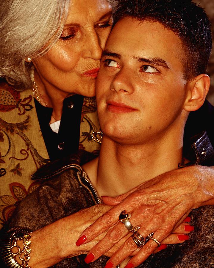 Mature Woman Caressing Young Man Photograph by Sean Ellis