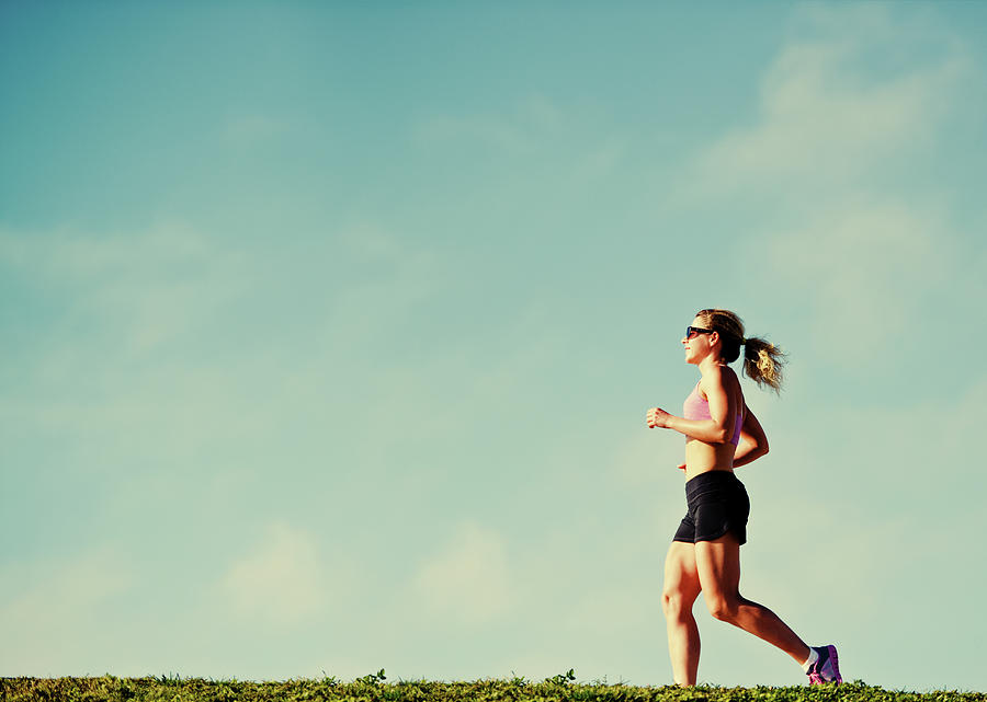 Mature Woman Jogging Outdoors Photograph by Anouchka