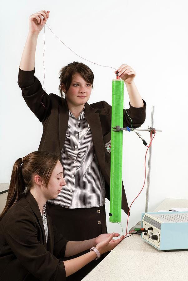 Two People Photograph - Measuring Electromagnetic Induction by Trevor Clifford Photography
