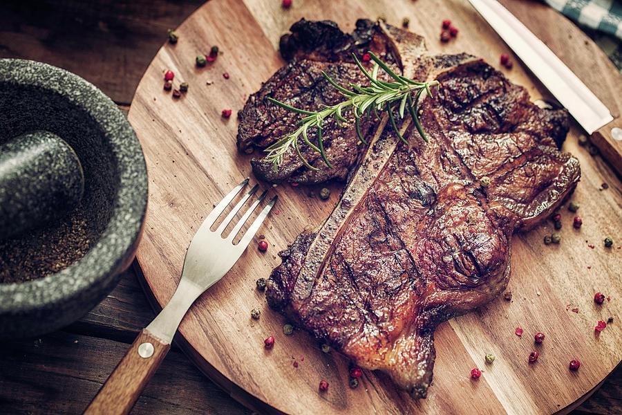 Medium Roasted T-bone Steak Photograph by Gmvozd
